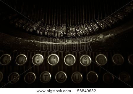 Rusty Dirty Typewriter Closeup Photo. Vintage Typewriter Background