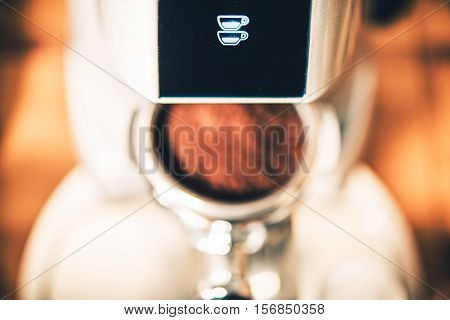 Double Shot Espresso Coffee Grinder Icon and the Shiny Portafilter Below