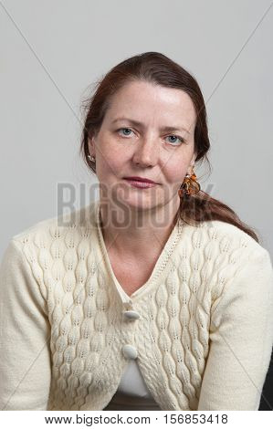 Portrait of a middle-aged woman with freckles