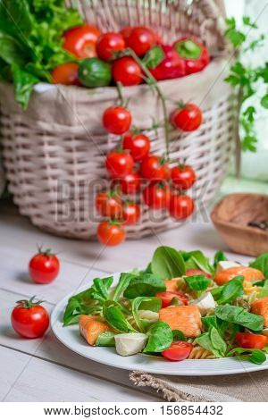 Healthy Salad With Salmon On Old Wooden Table