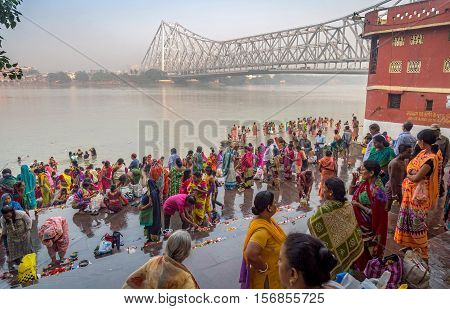 Devotees gather at the ganges river bank at Mallick ghat Kolkata, India for holy dip in the ganga waters on the occasion of Rash Purnima festival. Photograph taken on November 14, 2016.