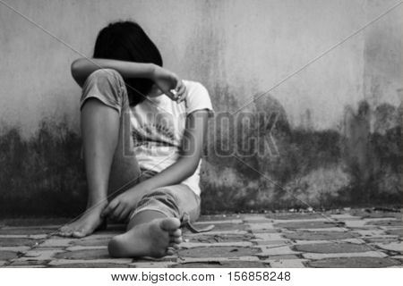Blurry of Concept teen problemTeen girl sad and stress black and white tone