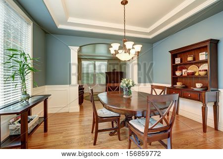 American Classic Dining Room Interior With Green Walls.