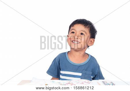 Cute child asian little boy happy and smiling while do homework art painting