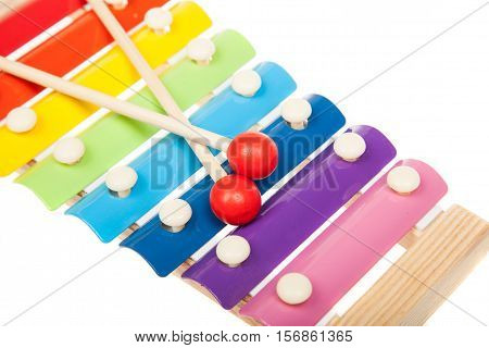 Rainbow colored toy xylophone isolated on white