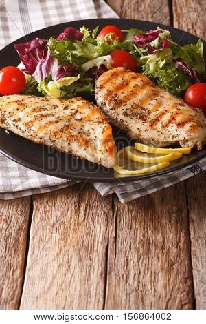 Healthy Food: Grilled Chicken And Mix Salad Of Chicory, Tomatoes, Kale And Lettuce Close-up. Vertica