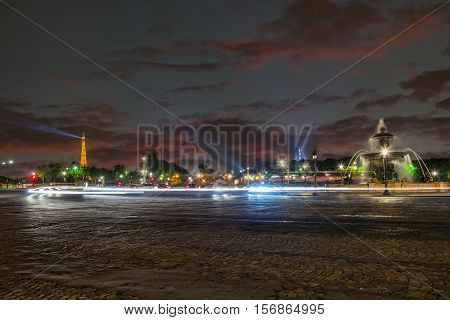 PARIS - MAY 14, 2010: Illuminated Eiffel tower at night from Place de la Concorde in Paris. The Eiffel tower is one of the most recognizable landmarks in the world.