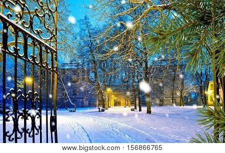 winter park with gateway by night in the snowfall