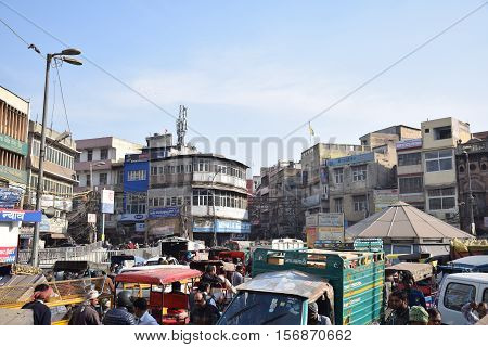 NEW DELHI, INDIA, FEBRUARY 02, 2016 - Unidentified crowd of people, cars, rickshaws and motorbikes in the busy area of Chandni Chowk in the old part of the city