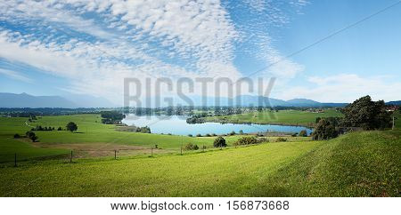Landscape Scenery With Fleecy Clouds