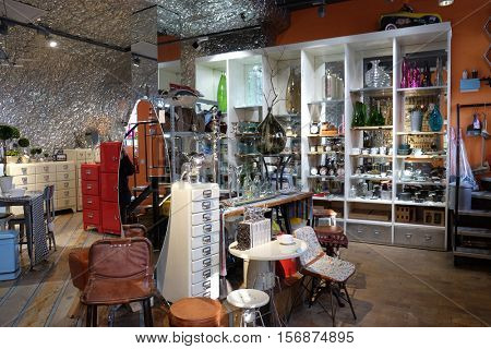 BEIJING - FEBRUARY 25, 2016: Souvenir store in 798 Art District. The 798 Art District is regarded as the biggest arts area in China and it has won international acclaim during last years.