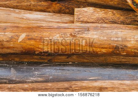 Moist Wood Posts Perched Like A Mound On The Floor
