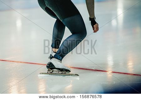 feet of athlete speed skater at start sprint race on ice rink. competitions in speed skating
