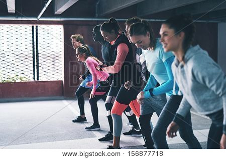 Group Of Diverse Young Friends Lining Up For A Run
