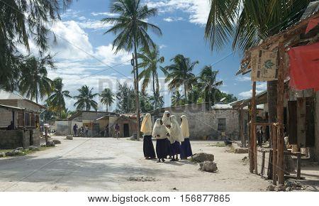 ZANZIBAR, TANZANIYA- JULY 13: group of schoolgirls near old village school on July 13, 2016 in Zanzibar