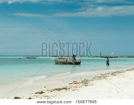 ZANZIBAR, TANZANIYA- JULY 09: seascape with fishing boats near african coast on July 09, 2016 in Zanzibar
