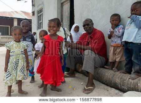 ZANZIBAR, TANZANIYA- JULY 13: curious smiling african children in village on July 13, 2016 in Zanzibar