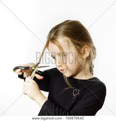 Cute Little Girl With Scissors. Self Hairdresser