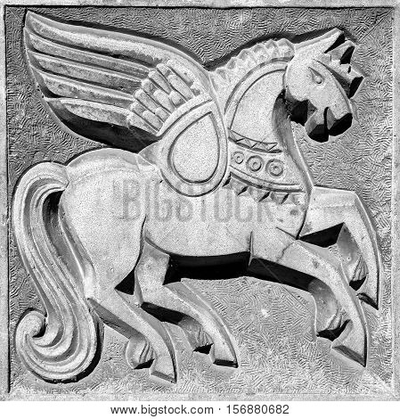 winged fairy horse stone bas-relief on the wall