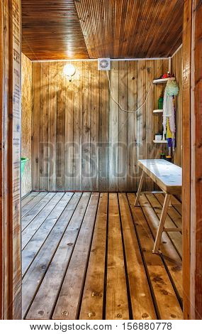 interior a rustic bath with wooden bench