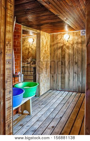 interior a rustic bath with two blue and green tubs