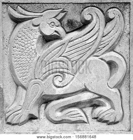 big winged fairy lion stone bas-relief on the wall