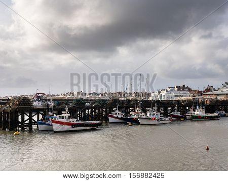BRIDLINGTON ENGLAND - NOVEMBER 6: Fishing trawler boats in Bridlington harbour. In Bridlington East Yorkshire England. On 6th November 2016.