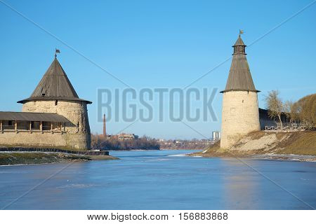 The old towers of the Pskov Kremlin on the place of confluence of Pskova and Velikaya on the sunny February day. Pskov Kremlin, Russia poster