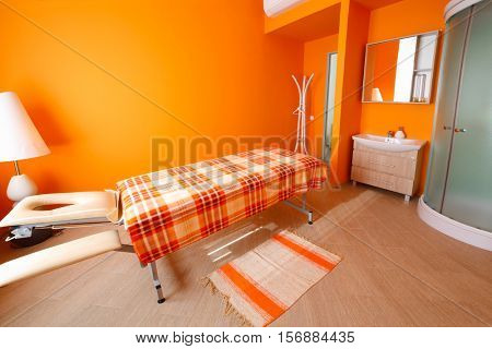 Empty bright room with table for massage, aromatherapy and relaxation