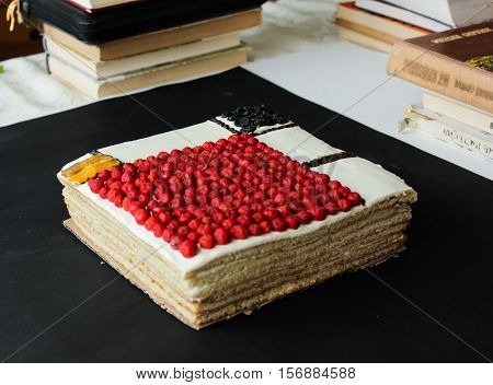 square cake with berries on a dark background. Mondrian