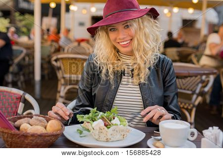 Happy and beautiful Woman having salad for lunch