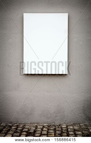Blank Vertical White Board On Grungy Gray Wall