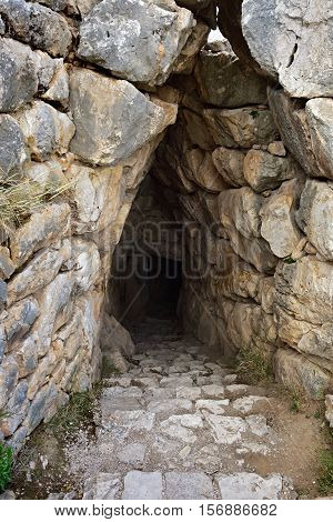 The entrance to the dungeon. The archaeological sites of Mycenae and Tiryns have been inscribed upon the World Heritage List of UNESCO