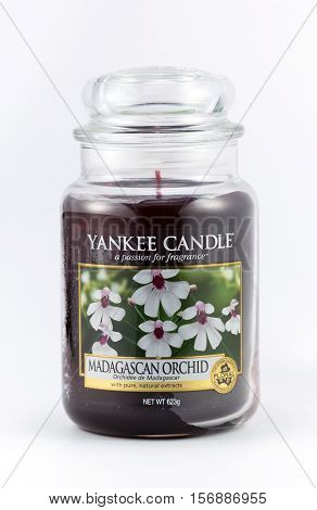 WREXHAM UK - OCTOBER 27 2016: Yankee candle in a jar floral Madagascar orchid scent. On a white background.