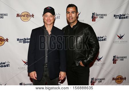 NEW YORK - MAY 21: Actors Gary Sinise (L) and J. W. Cortes attend a benefit concert at the Hard Rock Cafe on May 21, 2015 in New York City.