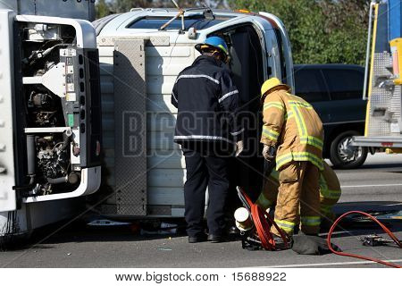 Emergency personnel at the scene of a turned truck