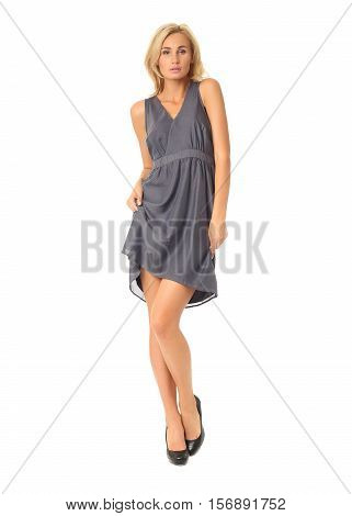 Full Length Of Flirtatious Woman In Cocktail Dress Isolated On White