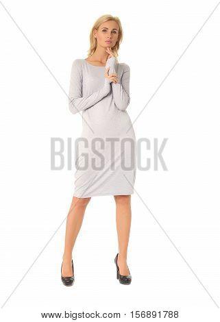 Full Length Of Flirtatious Woman In Gray Dress Isolated On White
