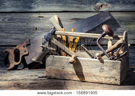 Vintage Carpenters Box With Tools On Old Wooden Table
