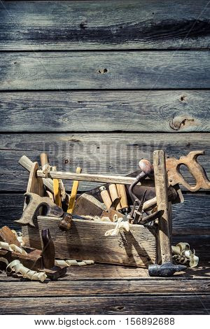 Old Joinery Box With Tools On Old Wooden Table