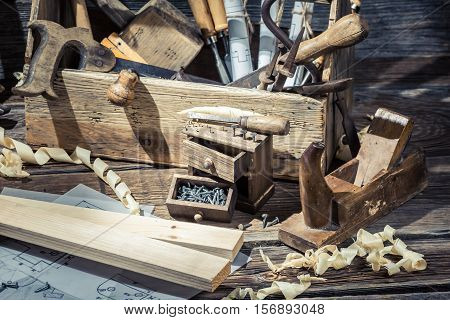 Old Carpentry Workshop With Toolbox On Old Wooden Table