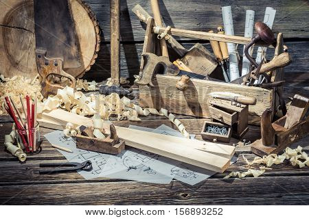 Old Carpentry Workshop With Tools On Old Wooden Table