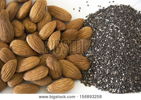 A pile of almonds and chia seeds