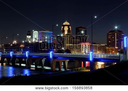 The skyline of the city of Des Moines lights up after dark. This night the Financial Center was lit up in rainbow colors in tribute of the Orlando mass shooting.