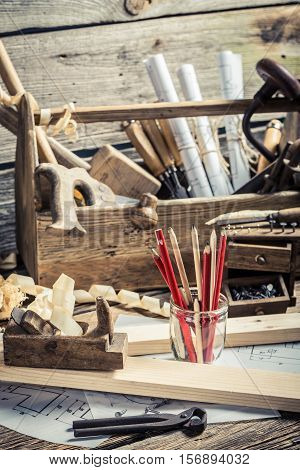 Drawing Workshop And Carpentry Workbench On Old Wooden Table