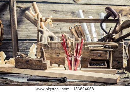 Drawing Workshop And Old Carpentry Workbench On Old Wooden Table