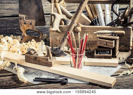 Old Carpentry Workbench And Drawing Workshop On Old Wooden Table