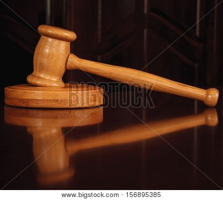 Wooden justice gavel and sound block on table