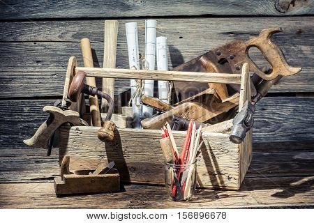 Hammer, Saw And Paper Scheme In The Carpentry Workbench