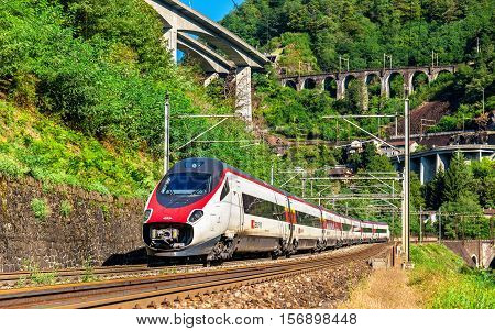 Giornico, Switzerland - September 25, 2016: Alstom ETR 610 tilting high-speed train on the Gotthard railway. The traffic will be diverted to the Gotthard Base Tunnel in December 2016.